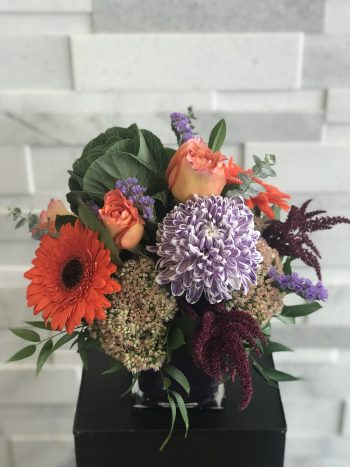 Pops of Purple Fall flower arrangement